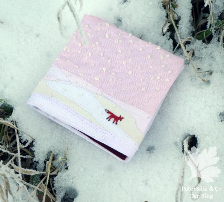 nadelbrief im schnee