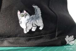Katze gestickt Logo Rucksack